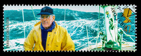 yachtsman: UNITED KINGDOM - CIRCA 2003: A used postage stamp printed in Britain celebrating British Explorers showing Yachtsman Francis Chichester and Gypsy Moth IV