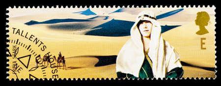 stark: UNITED KINGDOM - CIRCA 2003: A used postage stamp printed in Britain celebrating British Explorers showing Freya Stark