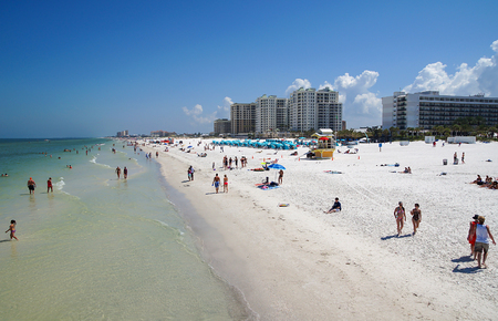 pinellas: CLEARWATER BEACH, FLORIDA, USA - 18 May 2013: Tourists on the beach enjoying the sun. Clearwater Beach is a popular vacation destination on the Gulf coast of Florida