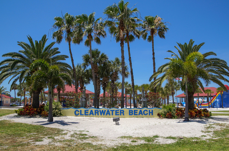 CLEARWATER BEACH, FLORIDA, USA - 18 May 2013: Welcome Sign in front of palm trees at Clearwater beach. Clearwater beach is a popular toursit destination on the Gulf coast of Florida