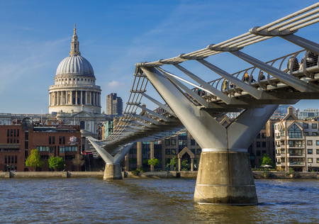 LONDON, UNITED KINGDOM - 3 JUNE 2014: Millennium Bridge crossing the River Thames, London with dome of Saint Pauls Cathedral in Background Editorial
