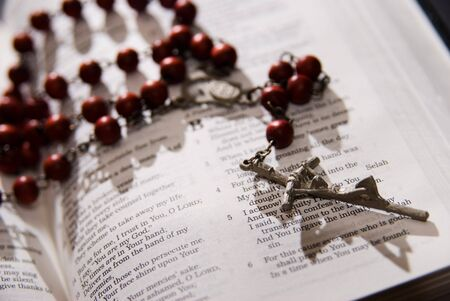 Rosary and cross on the Holy Bible