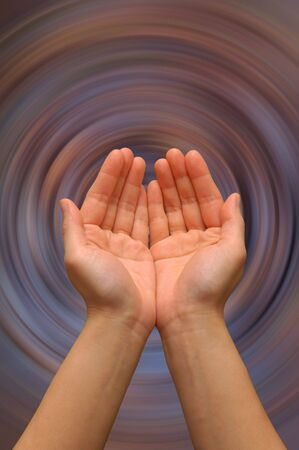 Cupped hands with spiral background Stock Photo