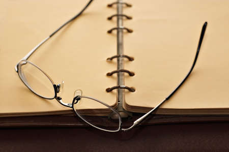 Open book with spectacles