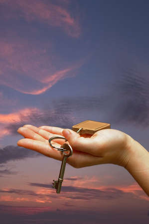 Hand holding key  Stock Photo