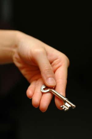 Hand holding key  Stock Photo
