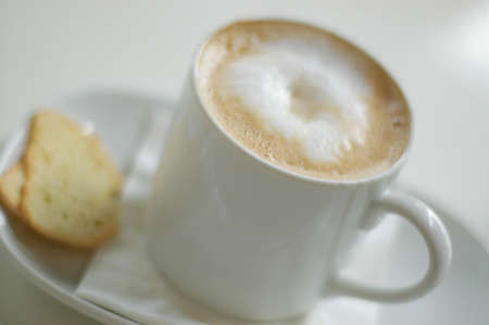 Coffee cup, cafe latte with biscotti