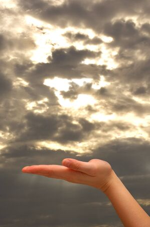 Outstretched hand with cloudy background  Stock Photo