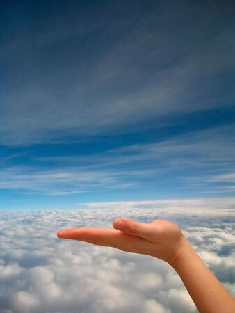 Outstretched hand with sky background