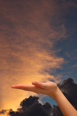 Outstretched hand with sunset background