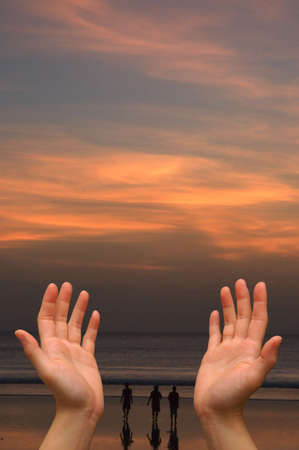 Cupped hands with sunset background  Stock Photo