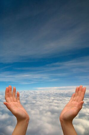 Cupped hands with sky background