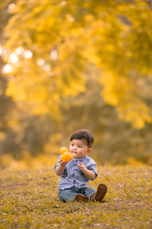 Asian 10-month old boy having fun outdoors