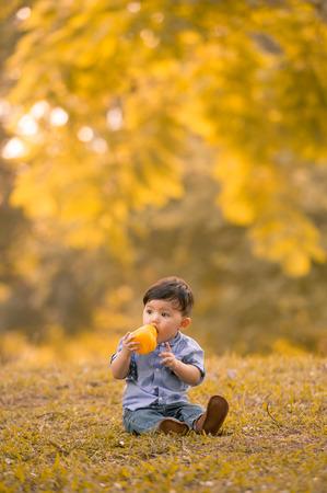 Asian 10-month old boy having fun outdoors