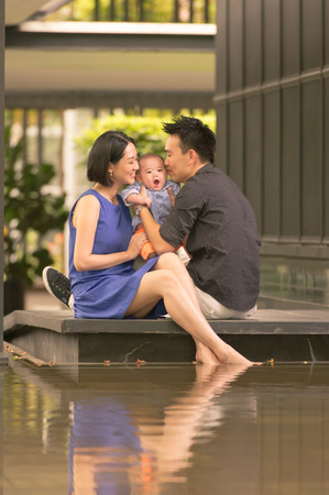 Young Asian Chinese family with 5 month old son photo