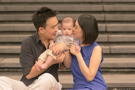 Young Asian Chinese family with 5 month old son