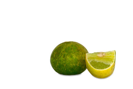 sliced and whole limes on white background Stock Photo