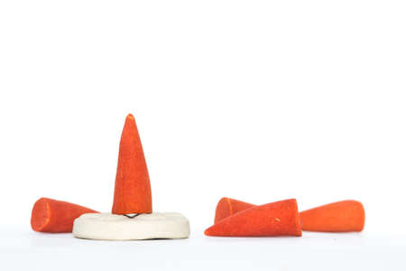 orange incense cones on white background Banque d'images