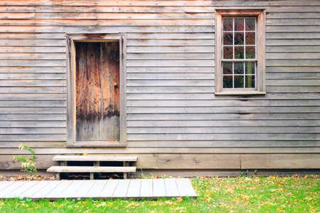Vintage wooden door, wall and window photo