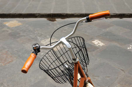 black grip: Yellow leather grip, black bicycle bell and front basket