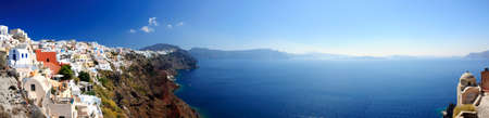 Panoramic view of Santorini village and volcanic bay, Greece photo