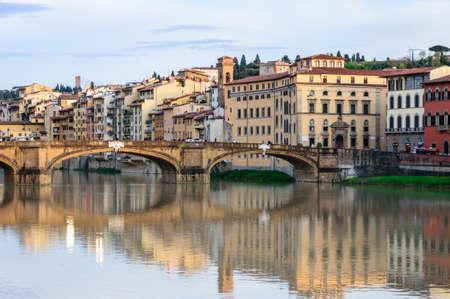 trinita: Ponte Santa Trinita reflected in the Arno River, Florence, Italy