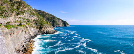 Rocky mountains on the coastline, Via del Amore in the national park Cinque Terre, Italy photo