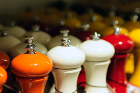 Orange, white and red pepper mills Stock Photo