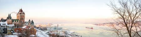 Quebec City skyline panorama with Chateau Frontenac viewed from hill during winter time