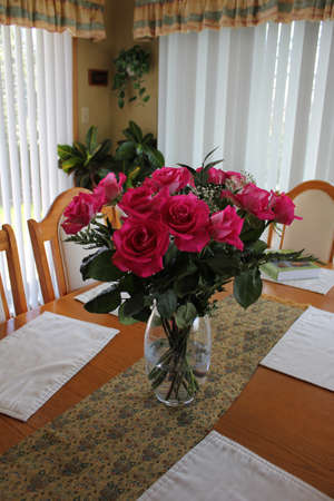 Red roses in a flower vase