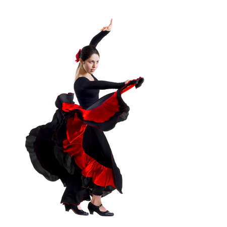 Portrait of beautiful young woman dancing flamenco isolated on white
