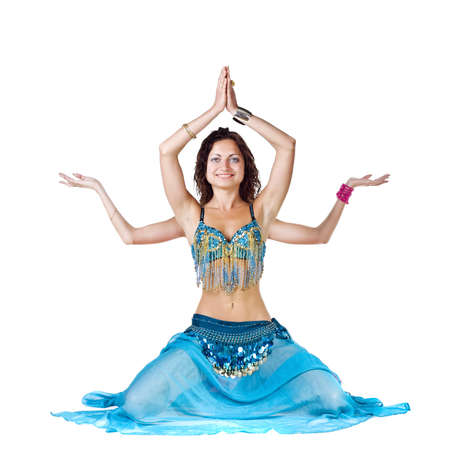 hindu god: Belly Dancer girl sits like a Shiva Stock Photo