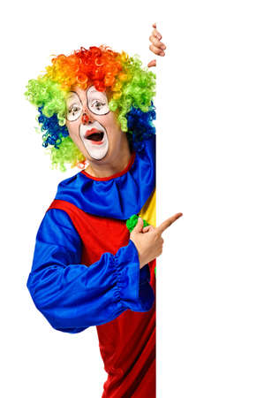 carnival costume: Happy clown holding the blank board and pointing  Isolated Stock Photo