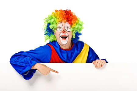 Funny clown standing over a white background and pointing photo