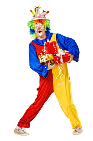 clown shoes: Birthday clown holding gift boxes  Isolated over white