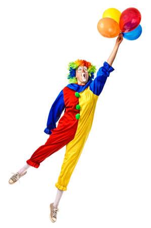 payaso: Flying payaso de cumpleaños con un montón de globos de cuerpo completo aislado Foto de archivo