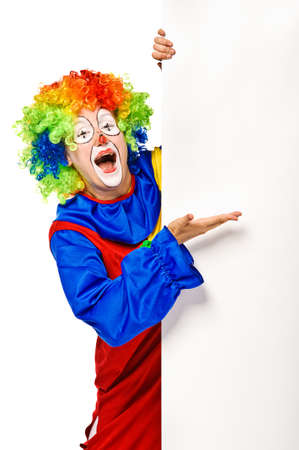 circus clown: Happy clown holding the blank board  Isolated