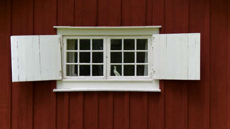 crossbars: Cottage with crossbar window and shutters Stock Photo