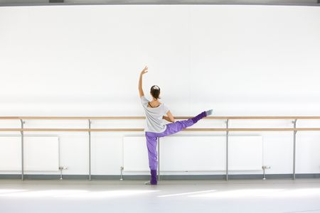 barre: Young ballerina at the barre Stock Photo