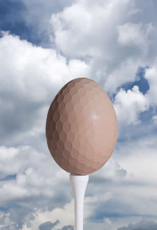 driving range: Dimpled Egg Golf Ball against Sky Stock Photo