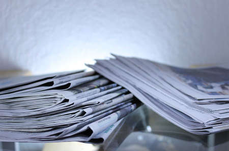 Stack of Newspapers on Table with Backlight