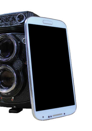 Smartphone and Vintage Twin lens Camera photo