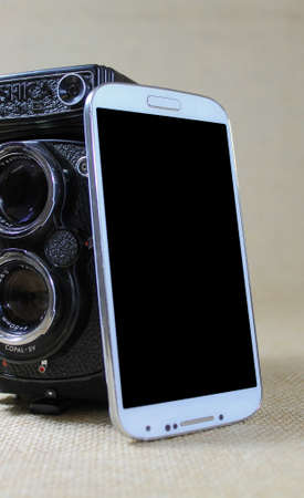 disparity: Smartphone and Vintage Twin lens Camera