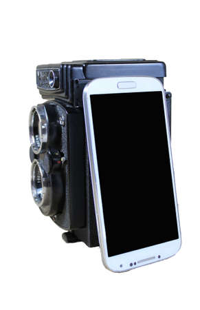 distinguish: Smartphone and Vintage Twin lens Camera
