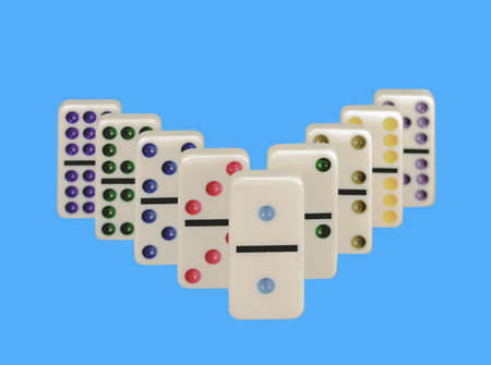 Close-up of dominos with colorful dots isolated against blue background. Imagens