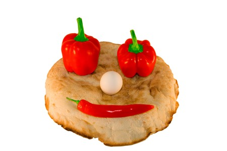 round smiling bread with vegetables and egg over white photo
