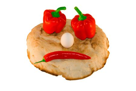 round smiling bread with vegetables and eggs over white photo