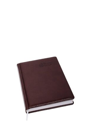 closed brown notebook isolated over white photo