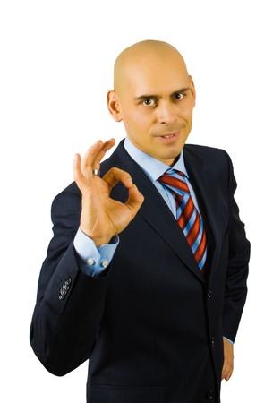 businessman show ok sing isolated on white  photo