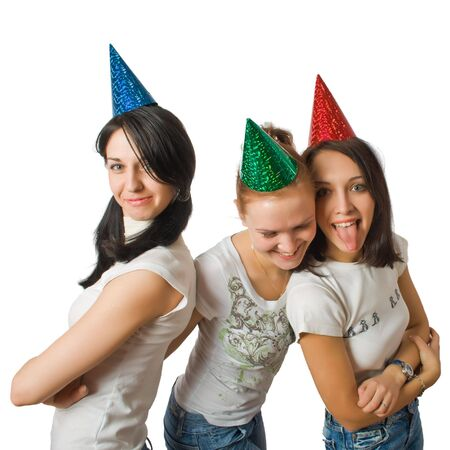 dunce cap: funny girls in fool caps isolated over white with path Stock Photo